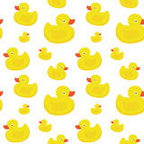 Cute yellow ducks seamless vector pattern on white background Royalty Free Stock Photos