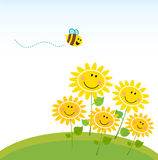 Cute yellow honey bee with group of flowers
