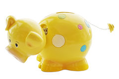 Cute yellow spotty piggy bank Royalty Free Stock Photos