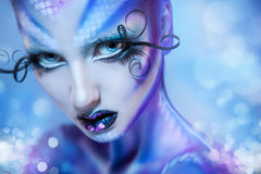 Cute young adult girl looking at camera with creative body art a Stock Photo