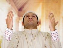 Cute young arabian guy praying to god Stock Photography
