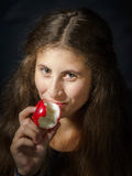 Cute young armenian girl with apple. Cute young armenian girl with red apple on black stock photo