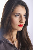 Cute young armenian girl looking right. Cute young armenian girl with red lips posing in studio royalty free stock images