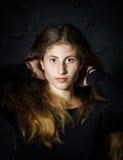 Cute young armenian girl posing in studio. On black stock photos