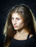 Cute young armenian girl posing in studio. On black royalty free stock photography