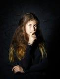 Cute young armenian girl posing in studio. On black royalty free stock image