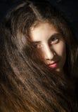 Cute young armenian girl posing in studio. On black stock photo