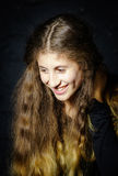Cute young armenian girl posing in studio. On black stock image