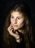 Cute young armenian girl posing in studio. On black royalty free stock photos
