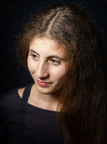 Cute young armenian girl posing in studio. Isolated on black royalty free stock images