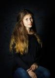 Cute young armenian girl posing in studio. Like Mona Lisa stock image