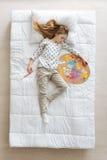 Cute young artist having a nap Stock Photos