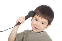 Cute young asian boy with microphone royalty free stock photo