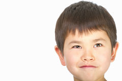 Cute young asian boy with a mischievous look royalty free stock photography