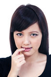 Cute Young Asian Woman Biting her Finger Royalty Free Stock Photography