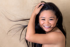 Cute Young Asian Woman With Blowing Hair Stock Photography