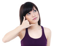 Cute Young Asian Woman Making A Call Me Gesture Stock Images