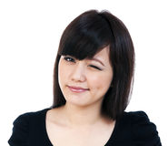 Cute Young Asian Woman Winking Royalty Free Stock Photography
