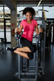 Cute young athlete raising leg shakes press Royalty Free Stock Photography