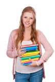 Cute young attractive student girl. Holding colorful exercise books Stock Photos