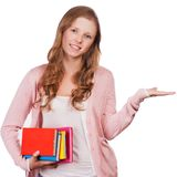 Cute young attractive student girl holding colorful exercise books. Royalty Free Stock Images