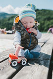 Cute young baby boy playing with a truck Royalty Free Stock Images