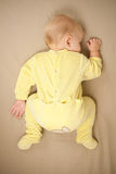 Cute young baby sleep on bed royalty free stock photos