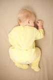 Cute young baby sleep on bed royalty free stock photo