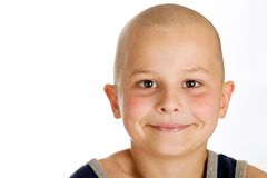 Cute young bald boy. A cute young boy with a bald head Royalty Free Stock Image