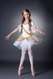 Cute young ballerina posing in elegant dress Royalty Free Stock Photo
