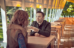 Cute young beautiful couple sitting on the restaurant Stock Image