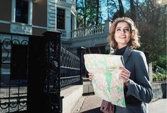 Free Cute Young Beautiful Curly Smiling Caucasian Travelling Woman Reading A Map Stock Photography - 147610512