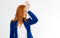 Cute, young beautiful red hair woman do facepalm. Redhead girl headache failed to upset business face palm. Portrait of female. Doing facepalm posing against stock photo