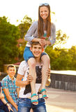 Cute young beautiful teens near university after studying and ha. Ving fun together laughing and smiling Stock Photography
