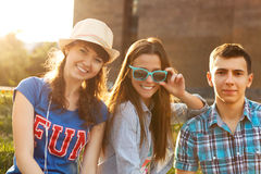 Cute young beautiful teens. Sitting in city near university after studying and having fun together laughing and smiling Stock Photo