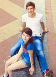 Cute young beautiful teens sitting in city near university after. Studying and having fun together laughing and smiling Stock Photos