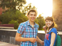 Cute young beautiful teens sitting in city near university after. Studying and having fun together laughing and smiling Stock Image
