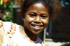 Cute young black African girl - poor child. Madagascar royalty free stock photos