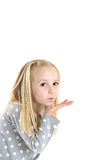 Cute young blond brown eyed girl blowing a kiss Royalty Free Stock Photos