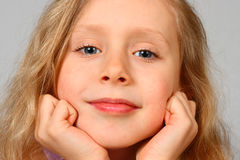 Cute young blond girl royalty free stock photography