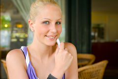 Cute young blond girl with her mobile phone. Stock Photos
