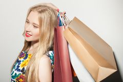 Cute young blond woman is purchasing with pleasure Royalty Free Stock Photography