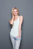 Cute young blond woman smiling Royalty Free Stock Photos