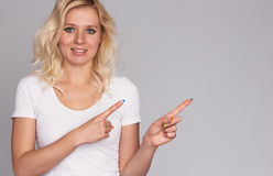 Cute young blonde girl with freckles. On white stock images