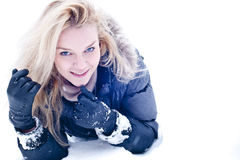 Cute young blonde on snowdrift Stock Photography