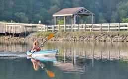 Cute young blonde woman - kayaking at lake Royalty Free Stock Photo