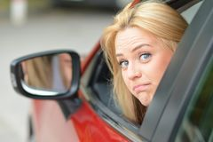 Something went wrong, I can`t start engine. Cute, young blue-eyed driver girl looking through window and asking for help with facial expression something went stock photos