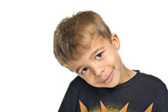Cute young boy. Portrait of cute young boy with head at jaunty angle, isolated on white background Stock Photos