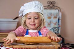 Cute young boy baking Royalty Free Stock Images