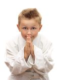 Cute young boy bowing Stock Photo